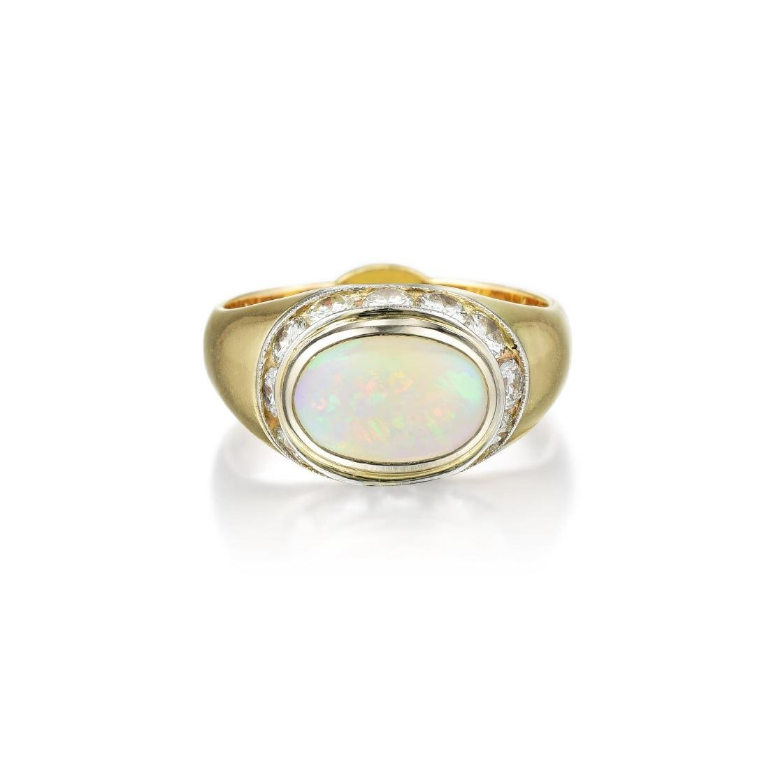 A 14K Gold Opal and Diamond Ring