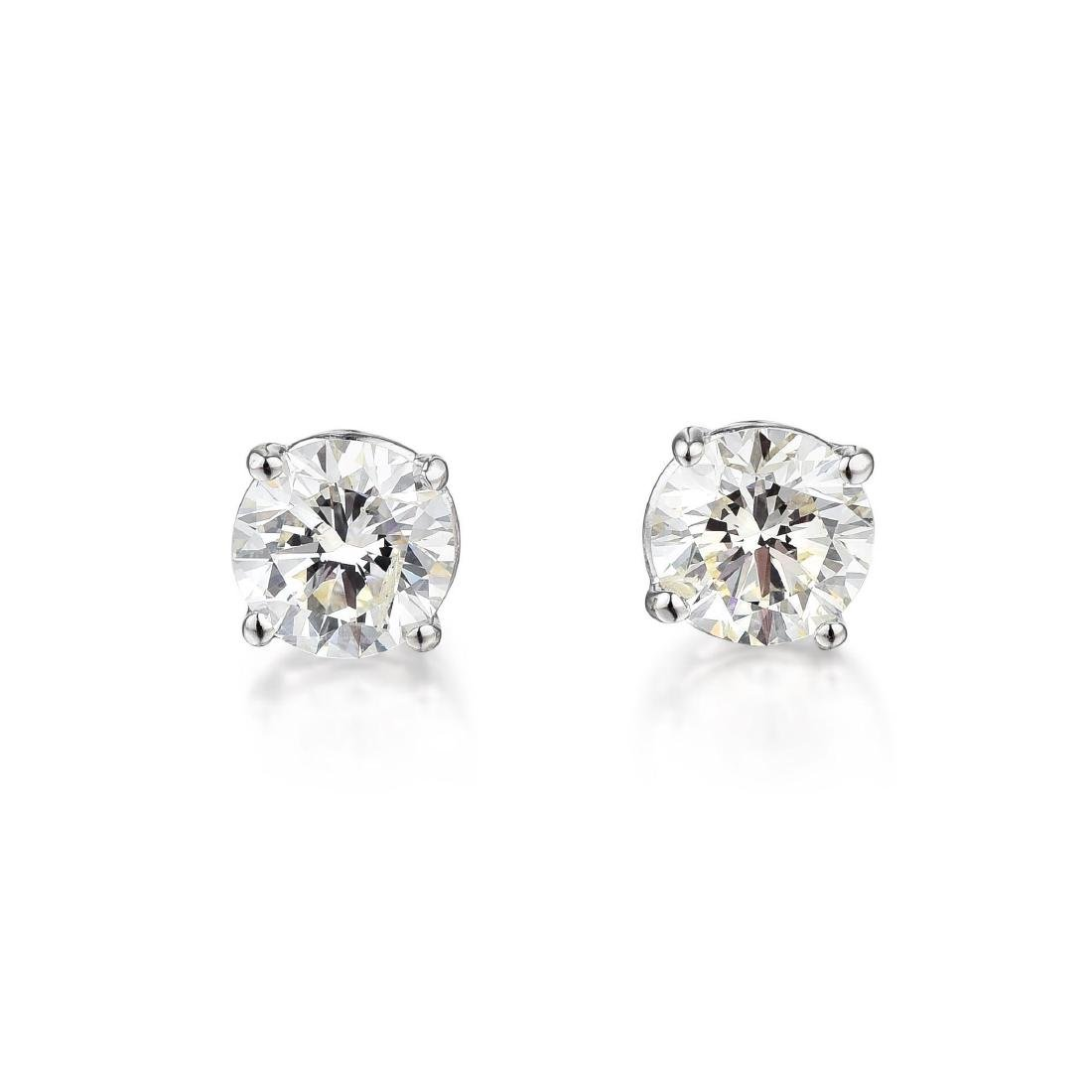 A Pair of 14K Gold Diamond Stud Earrings