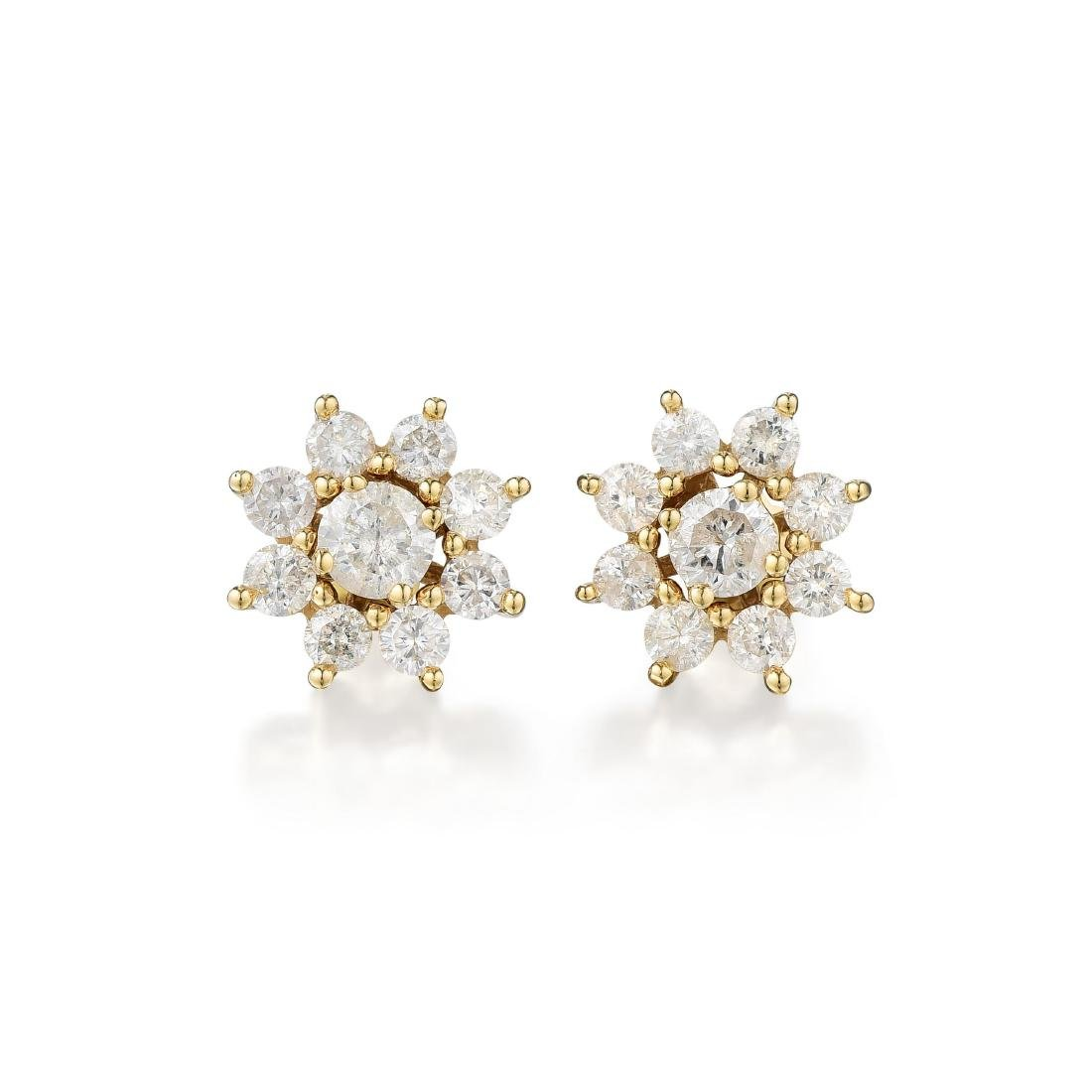 A Pair of 14K Gold Diamond Earrings