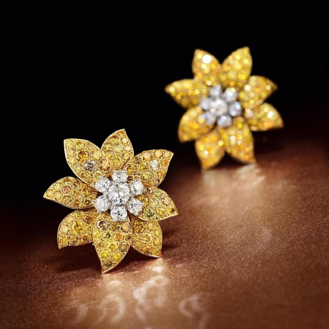 A Pair of  Fancy Yellow Diamond Earclips