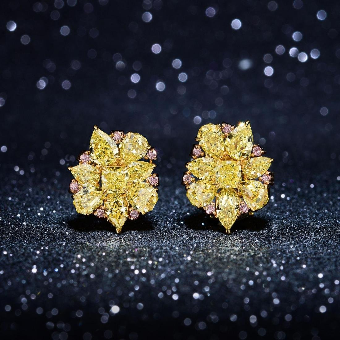 A Pair of Fancy Yellow and Pink Diamond Earclips