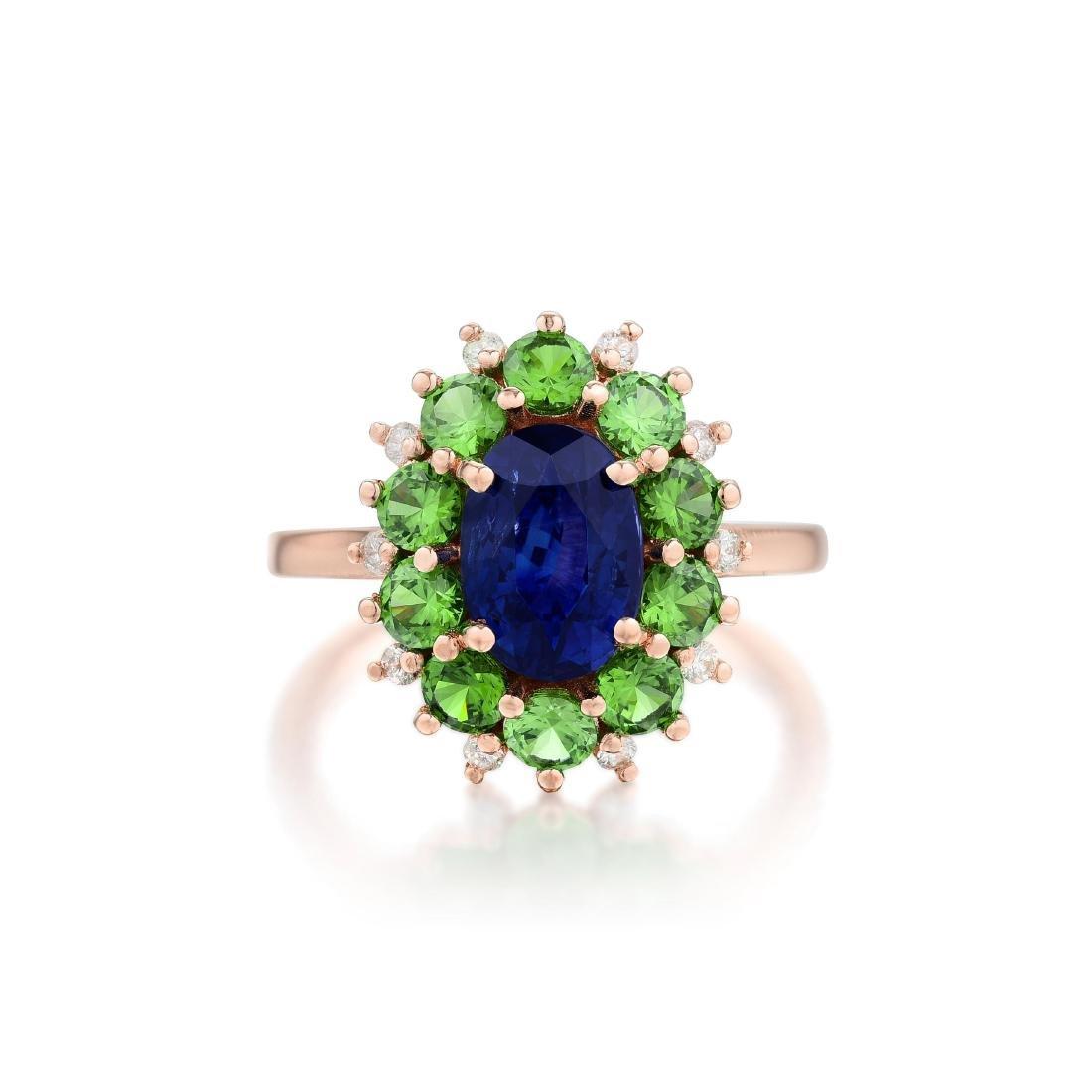 A Sapphire Demantoid Garnet and Diamond Ring