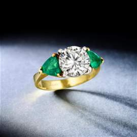 A 3.01-Carat Diamond and Emerald Ring