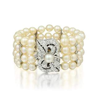 A Four Strand Cultured Pearl and Diamond Bracelet