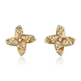 A Pair of Diamond Pinwheel Earclips