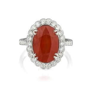 An Orange Sapphire and Diamond Ring