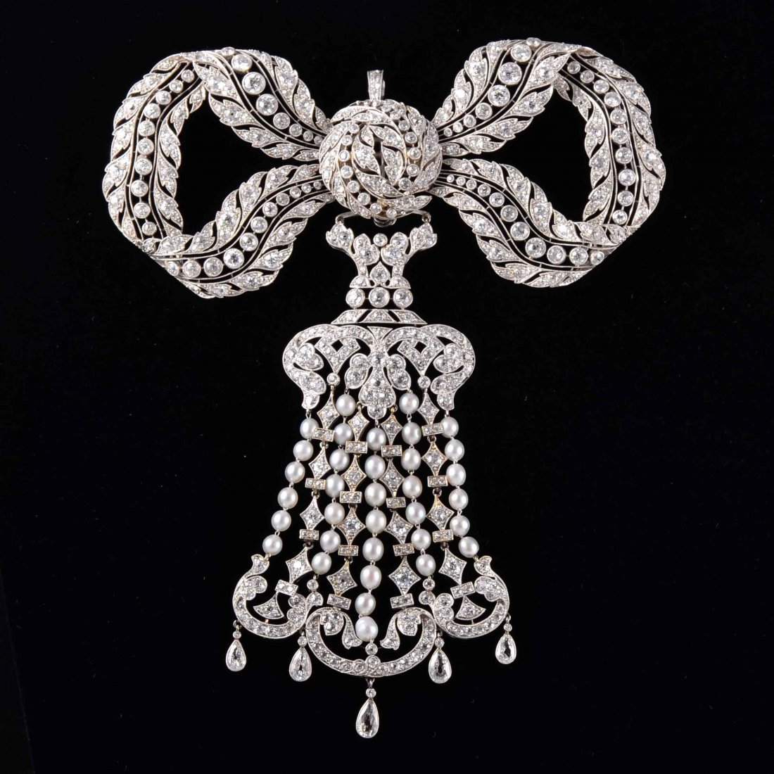 Important Bell Epoque natural pearl diamond bow brooch