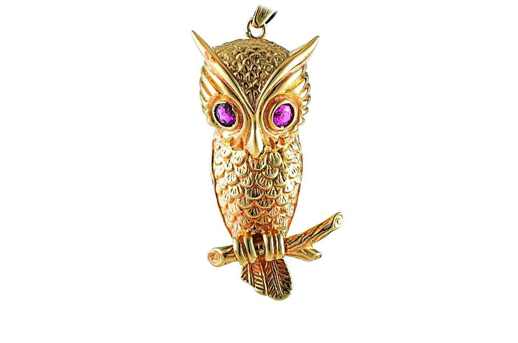 An Owl Pendant with Ruby Eyes