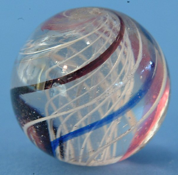 11: White Latticino Core Marble w/red, blue & purple ou