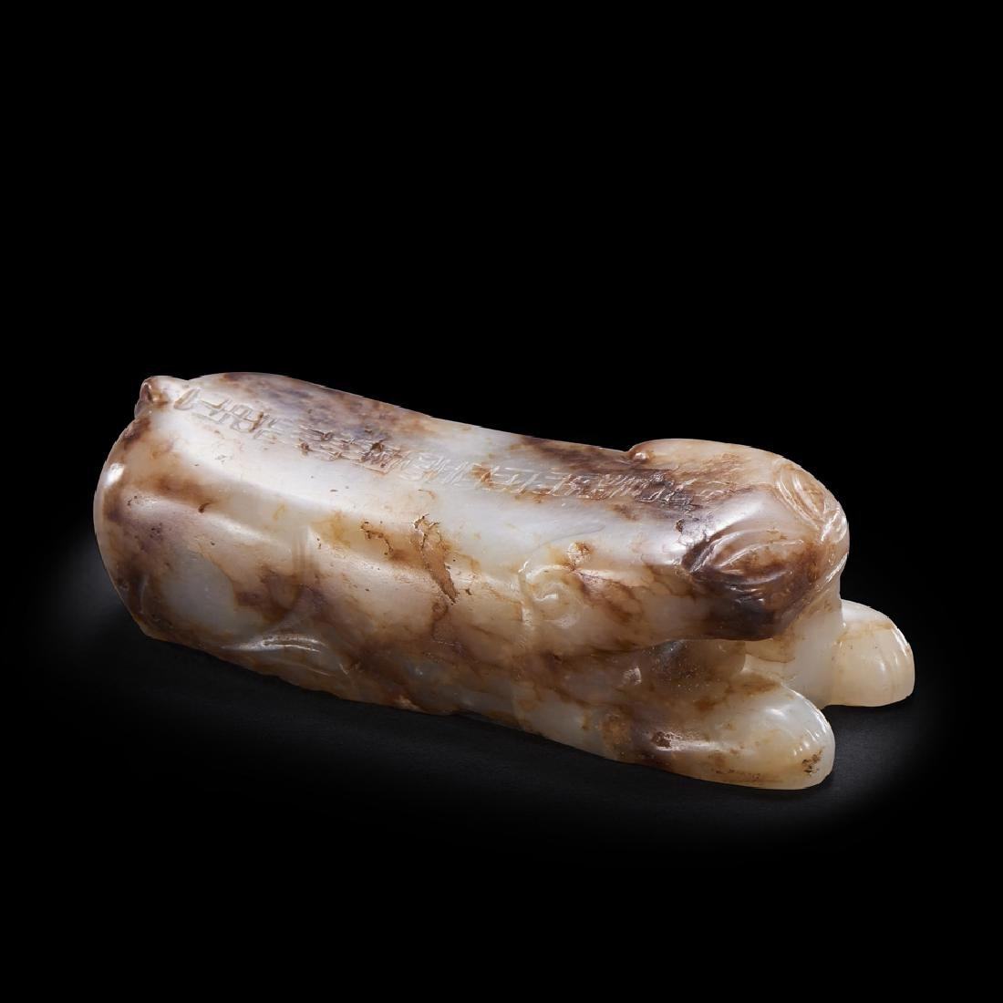A CHINESE INSCRIBED WHITE AND RUSSET JADE TIGER TALLY