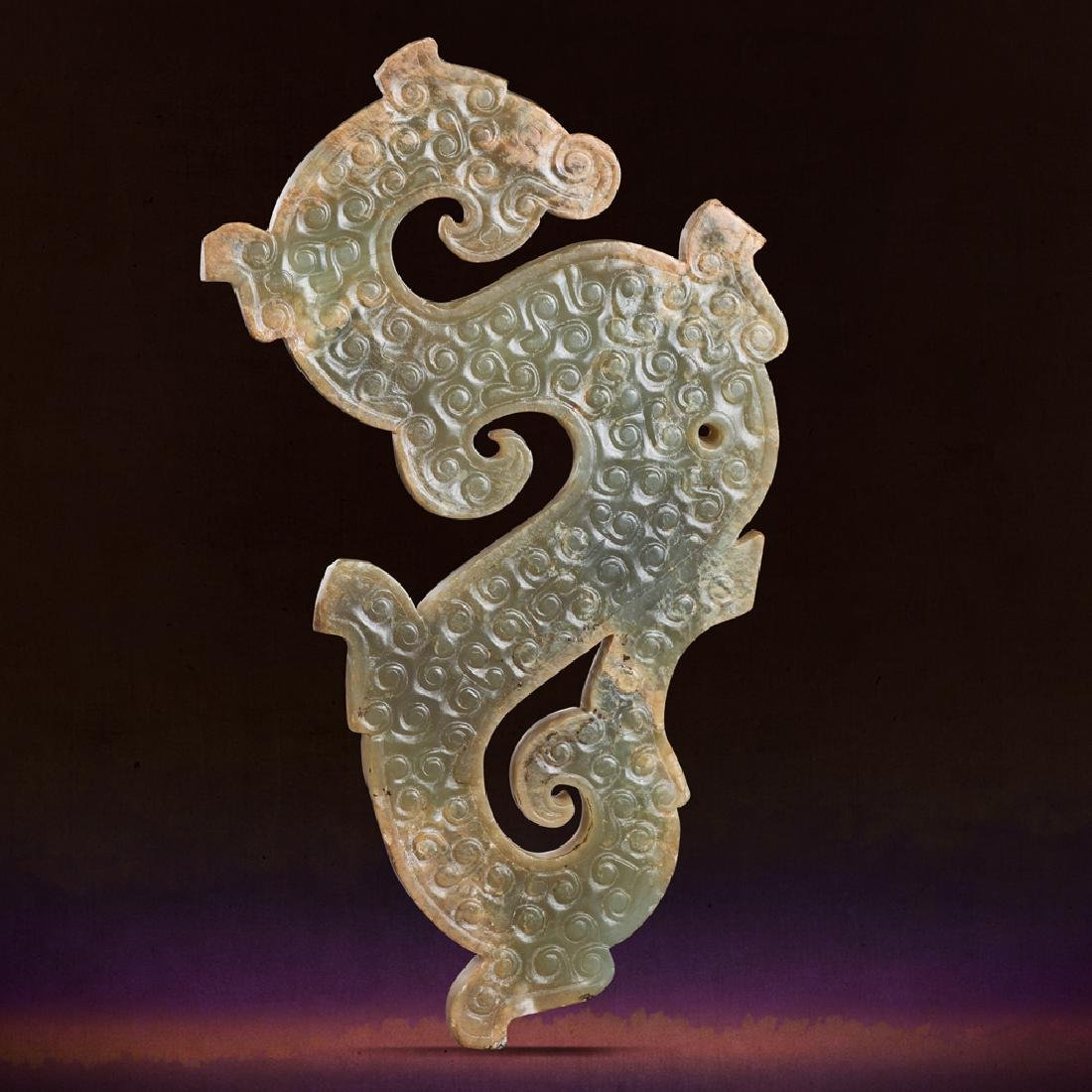 A CHINESE PALE CELADON JADE 'DRAGON-SHAPED' PENDANT