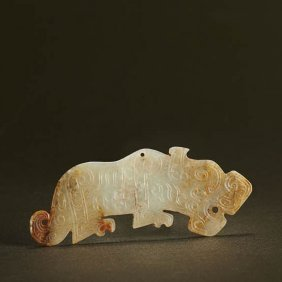 A Chinese White And Russet Jade Tiger Pendant
