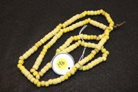 strand of rare yellow Padre trade beads