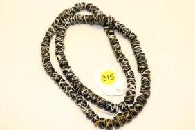strand of rattlesnake trade beads