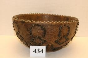 heavily tacked carved wood bowl