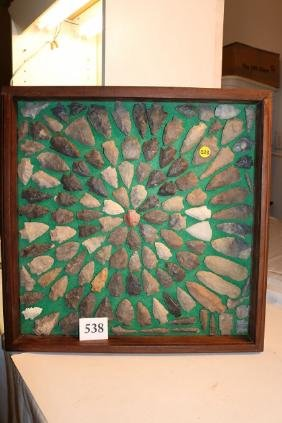 frame of assorted arrowheads