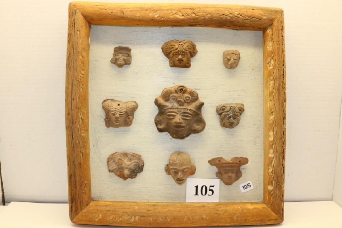 9 Pottery Mayan Heads