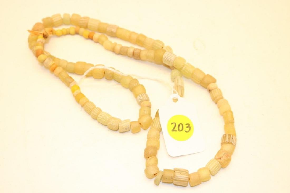 Strand of Vaseline Glass Stripe Beads