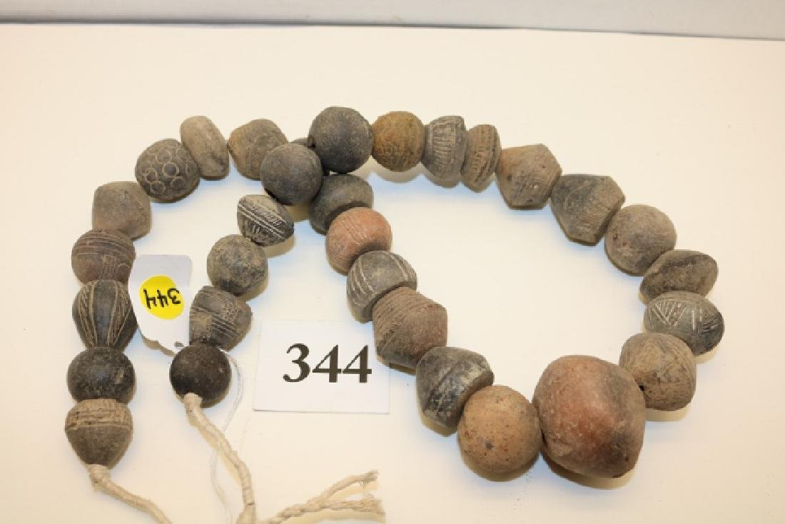 Strand of Engraved Pottery Beads