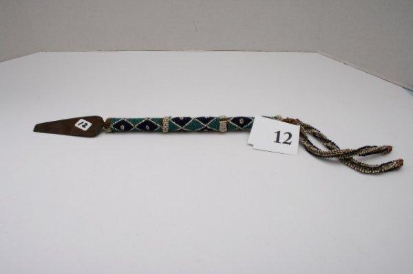 12: Beaded Handle Metal Tip Dagger