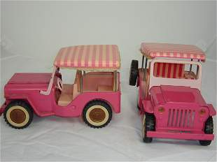 Two pink Tonka Toy Jeeps