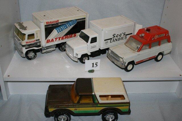 15: 4 Various Tin Trucks