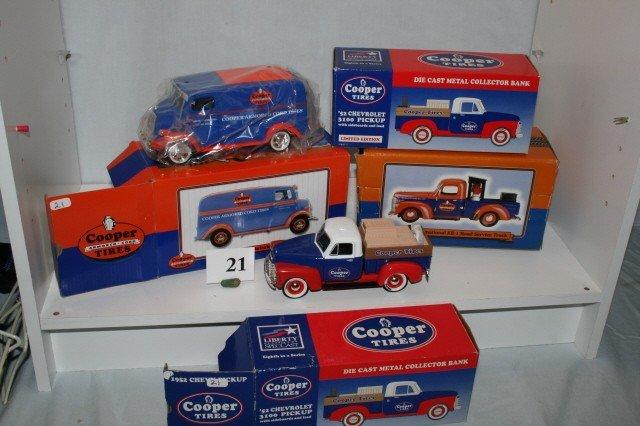 "21: 4  ""Cooper Tires"" Delivery Trucks"