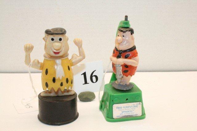 16: Fred Flintstone push up toys