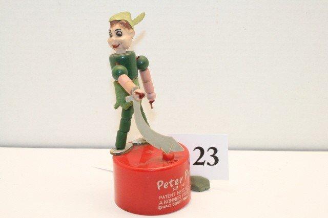 23: Peter Pan push up toy