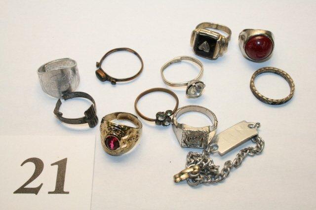 21: Bracelet, several rings