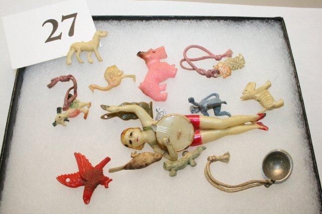 27: Plastic Figures in frame