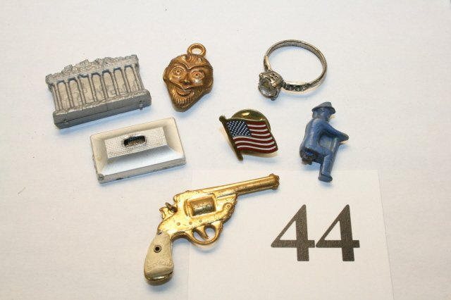 44: Gun, Ring, charms