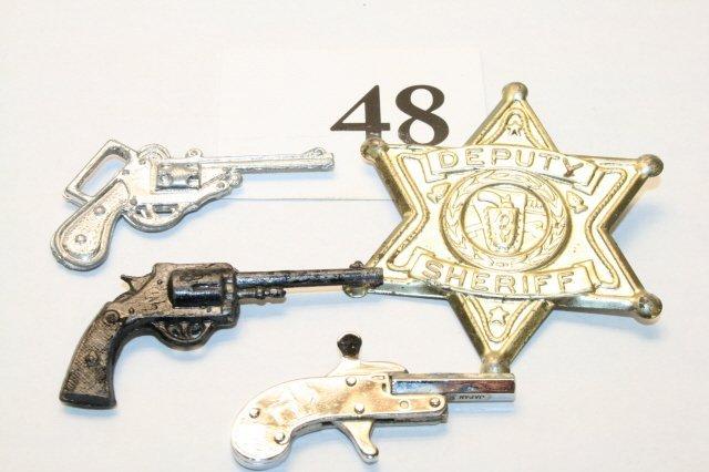 48: Tin Badge, 3 guns