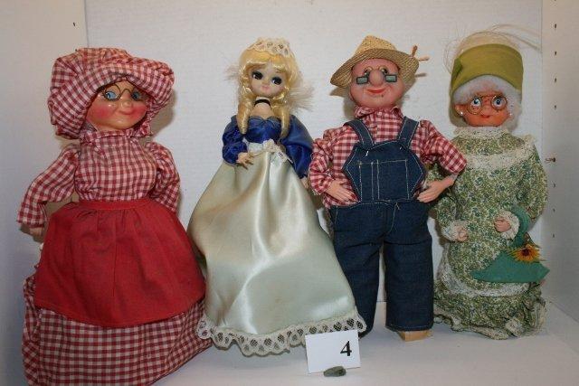 4 Assorted Dolls