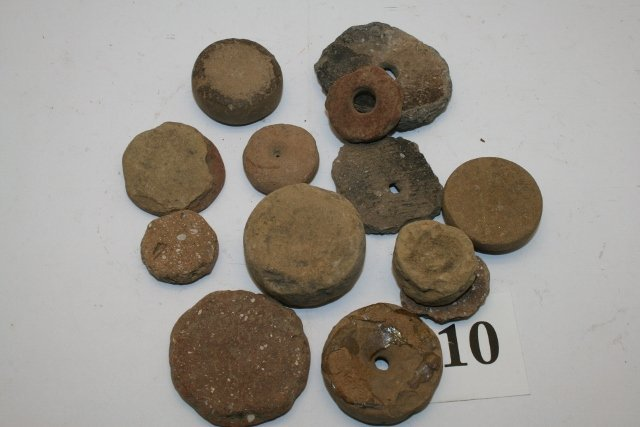 12 Pottery and Stone Discoidals