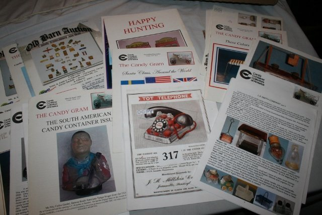 Assorted Auction Catalogs on Candy Containers