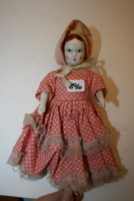 Small China Doll with original clothes