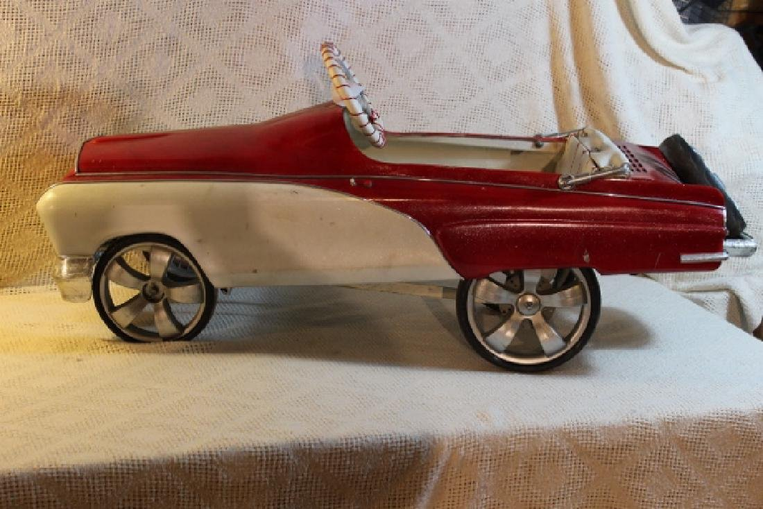 Red and White Pedal Car
