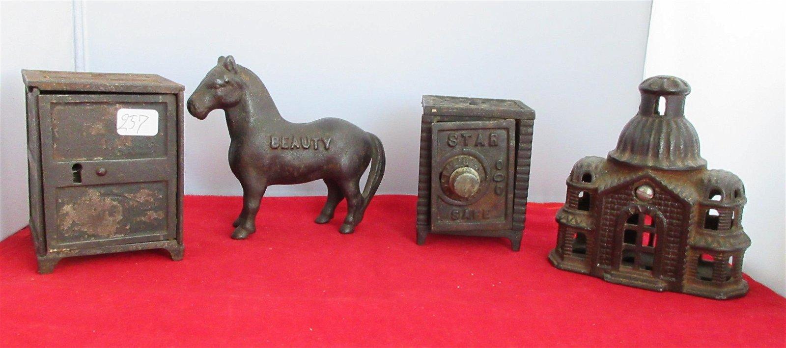 Four antique cast iron banks.
