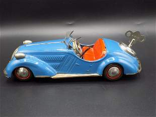 Unusual vintage tin toy windup car that shifts gears.