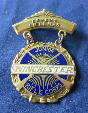 Nice vintage 10k gold Winchester Junior rifle Corps.