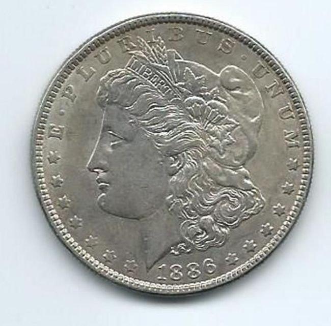 Beautiful 1886 AU/BU Morgan Silver dollar. See photos