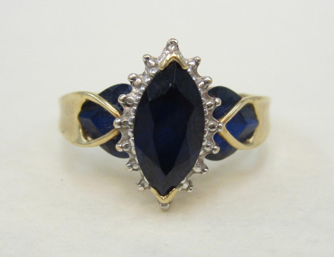 Beautiful 10 K - , 2 CT. Saphire  and diamond ring