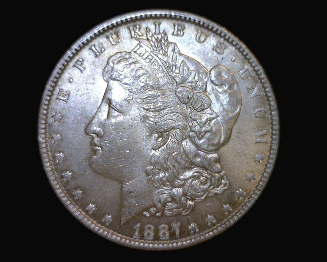 Au/Bu 1887 Morgan Silver Dollar