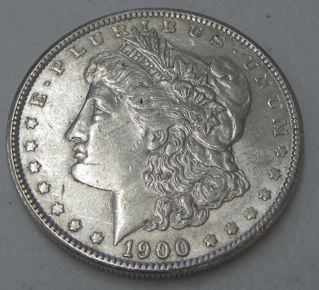 Au/Bu 1900 MORGAN SILVER DOLLAR