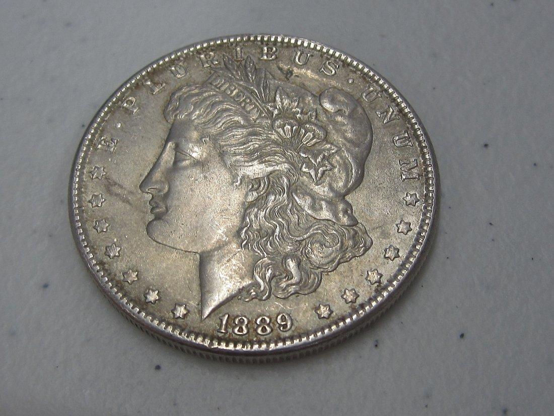 Au/Bu 1889 MORGAN SILVER DOLLAR