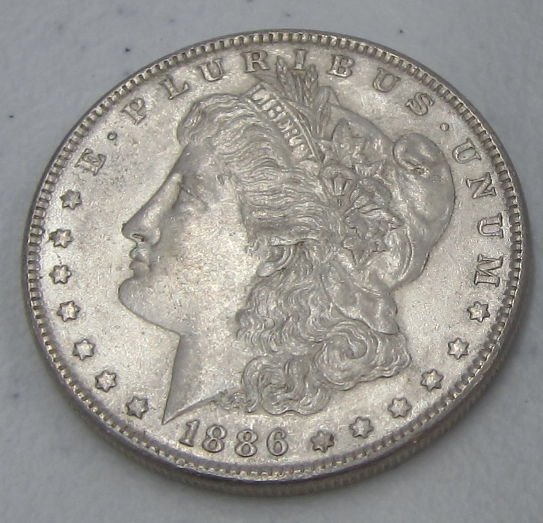 Au/Bu 1886 MORGAN SILVER DOLLAR