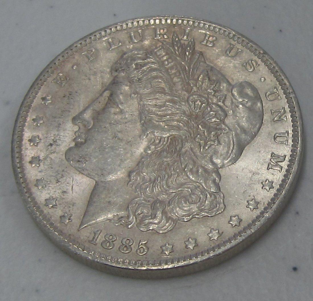 Au/Bu 1885 o MORGAN SILVER DOLLAR