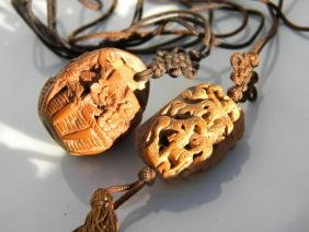 Pair of antique Carved Nut Pit Horse Pendants