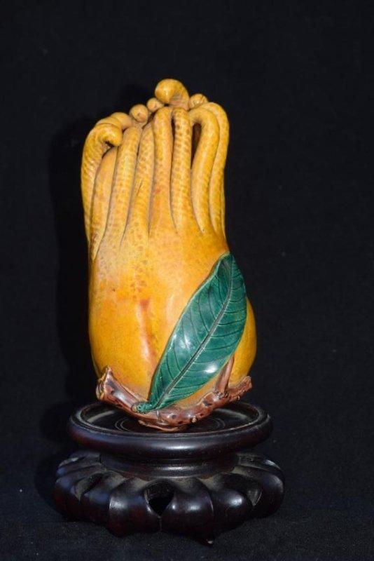 A YELLOW GLAZED BUDDHA'S HAND